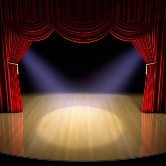 Theatre stage with red curtain and spotlights on the stage floor.